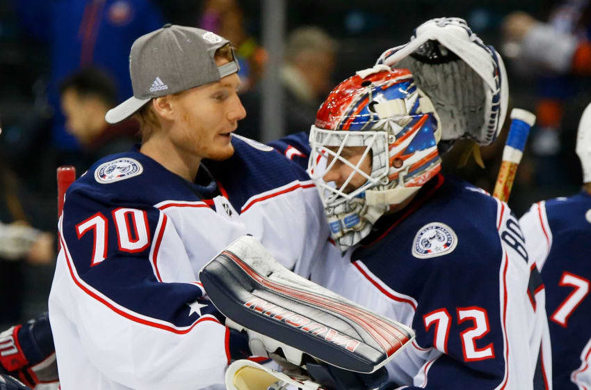 NEW YORK, NY - FEBRUARY 13: Joonas Korpisalo #70 of the Columbus Blue Jackets congratulates Sergei Bobrovsky #72 on a 4-1 win against the New York Islanders at Barclays Center on February 13, 2018 in New York City. (Photo by Jim McIsaac/NHLI via Getty Images)