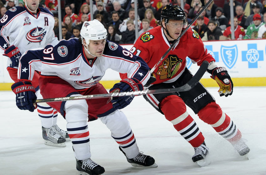 CHICAGO - DECEMBER 26: Rostislav Klesla #97 of the Columbus Blue Jackets and Marian Hossa #81 of the Chicago Blackhawks watch for the puck on December 26, 2010 at the United Center in Chicago, Illinois. (Photo by Bill Smith/NHLI via Getty Images)