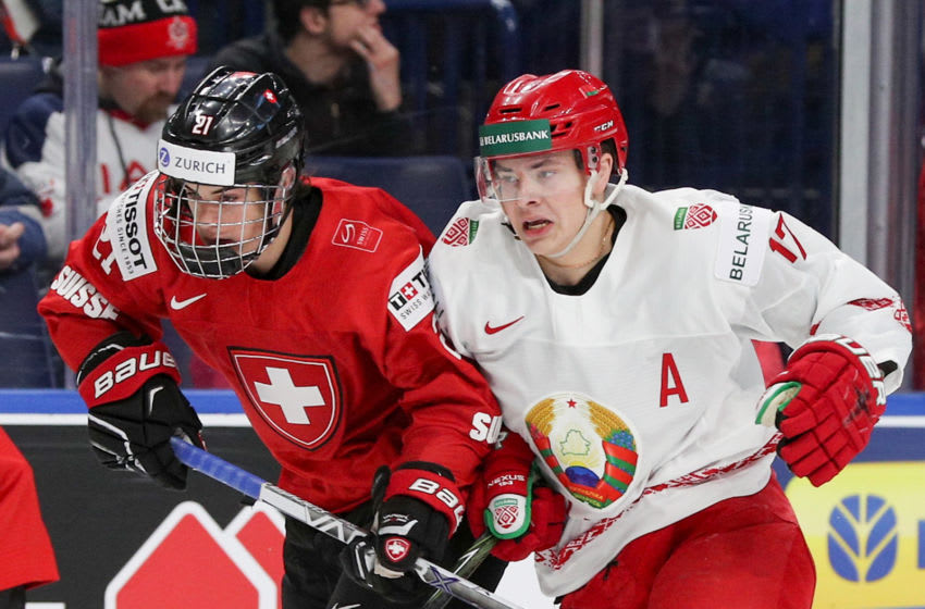 BUFFALO, NY - DECEMBER 27:Yegor Sharangovich #17 of Belarus battles with Tim Berni #21 of Switzerland during the first period of play in the IIHF World Junior Championships at the KeyBank Center on December 27, 2017 in Buffalo, New York. (Photo by Nicholas T. LoVerde/Getty Images)