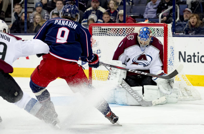 COLUMBUS, OH - MARCH 08: Columbus Blue Jackets left wing Artemi Panarin (9) attempts a shot on goal as Colorado Avalanche goaltender Semyon Varlamov (1) blocks in the third period of a game between the Columbus Blue Jackets and the Colorado Avalanche on March 08, 2018 at Nationwide Arena in Columbus, OH. The Blue Jackets won 5-4. (Photo by Adam Lacy/Icon Sportswire via Getty Images)