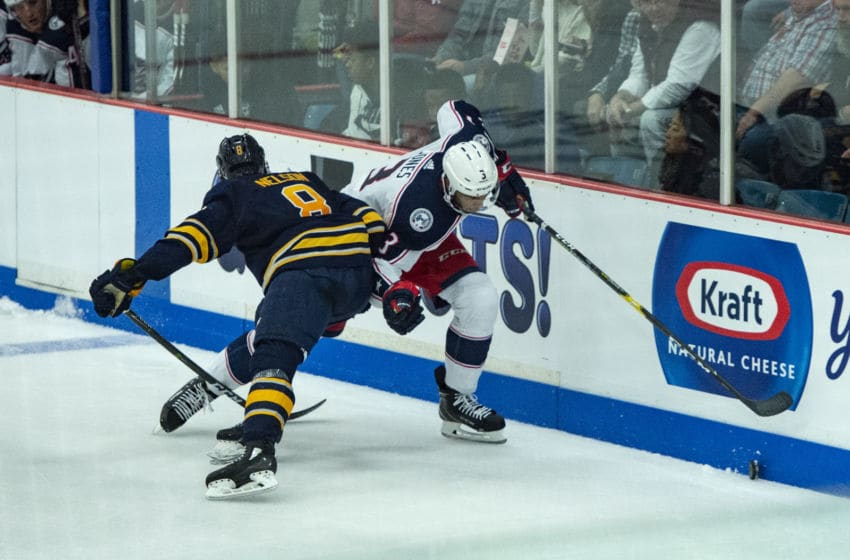CLINTON, NY - SEPTEMBER 25: Buffalo Sabers Right Defenseman Casey Nelson (8) checks Columbus Blue Jackets Defenseman Seth Jones (3) into the boards during the second period of the Columbus Blue Jackets versus the Buffalo Sabers preseason game on September 25, 2018, at Clinton Arena in Clinton, New York. (Photo by Gregory Fisher/Icon Sportswire via Getty Images)