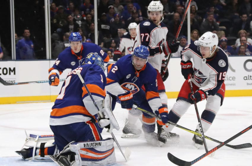 UNIONDALE, NEW YORK - MARCH 11: Thomas Greiss #1 of the New York Islanders makes the third period save against Ryan Dzingel #19 of the Columbus Blue Jackets at the NYCB Live's Nassau Coliseum on March 11, 2019 in Uniondale, New York. The Islanders hut-out the Blue Jackets 2-0. (Photo by Bruce Bennett/Getty Images)
