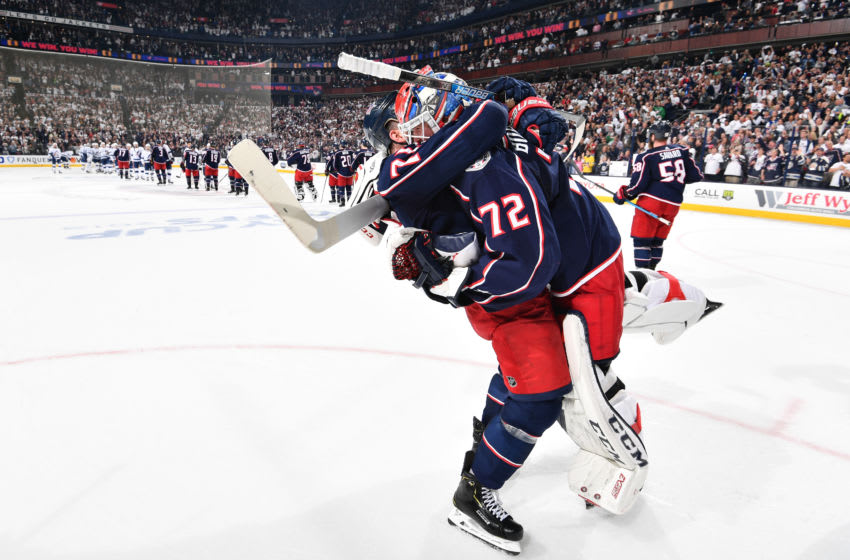 COLUMBUS, OH - APRIL 16: Nick Foligno #71 of the Columbus Blue Jackets celebrates with goaltender Sergei Bobrovsky #72 of the Columbus Blue Jackets after winning Game Four of the Eastern Conference First Round during the 2019 NHL Stanley Cup Playoffs on April 16, 2019 at Nationwide Arena in Columbus, Ohio. Columbus defeated Tampa Bay 7-3 to win the series 4-0. (Photo by Jamie Sabau/NHLI via Getty Images)
