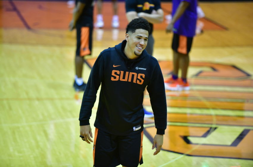 PHOENIX, AZ - OCTOBER 2: Devin Booker #1 of the Phoenix Suns looks on during the Phoenix Suns NBA all access practice on October 2, 2018, at Talking Stick Resort Arena in Phoenix, Arizona. NOTE TO USER: User expressly acknowledges and agrees that, by downloading and or using this Photograph, user is consenting to the terms and conditions of the Getty Images License Agreement. Mandatory Copyright Notice: Copyright 2018 NBAE (Photo by Barry Gossage/NBAE via Getty Images)