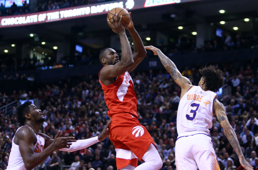 TORONTO, ON - JANUARY 17: Serge Ibaka #9 of the Toronto Raptors shoots the ball as Deandre Ayton #22 and Kelly Oubre Jr. #3 of the Phoenix Suns defend during the second half of an NBA game at Scotiabank Arena on January 17, 2019 in Toronto, Canada. NOTE TO USER: User expressly acknowledges and agrees that, by downloading and or using this photograph, User is consenting to the terms and conditions of the Getty Images License Agreement. (Photo by Vaughn Ridley/Getty Images)