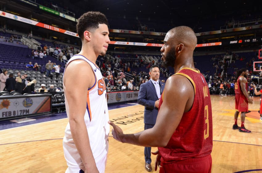 PHOENIX, AZ - FEBRUARY 4: Devin Booker #1 of the Phoenix Suns and Chris Paul #3 of the Houston Rockets talk after the game on February 4. 2019 at Talking Stick Resort Arena in Phoenix, Arizona. NOTE TO USER: User expressly acknowledges and agrees that, by downloading and/or using this photograph, user is consenting to the terms and conditions of the Getty Images License Agreement. Mandatory Copyright Notice: Copyright 2019 NBAE (Photo by Barry Gossage/NBAE via Getty Images)