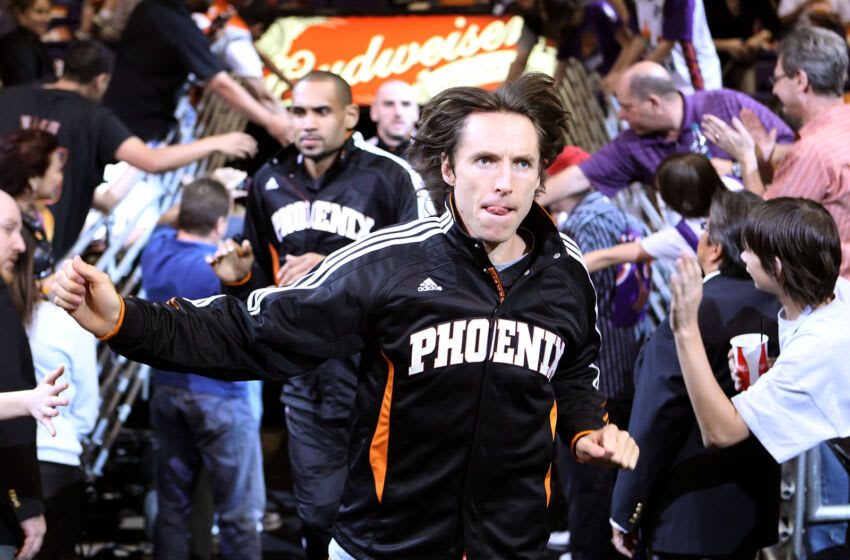 PHOENIX, AZ - APRIL 13: Steve Nash #13 of the Phoenix Suns runs out onto the court for warm ups to the NBA game against the San Antonio Spurs at US Airways Center on April 13, 2011 in Phoenix, Arizona. NOTE TO USER: User expressly acknowledges and agrees that, by downloading and or using this photograph, User is consenting to the terms and conditions of the Getty Images License Agreement. (Photo by Christian Petersen/Getty Images)