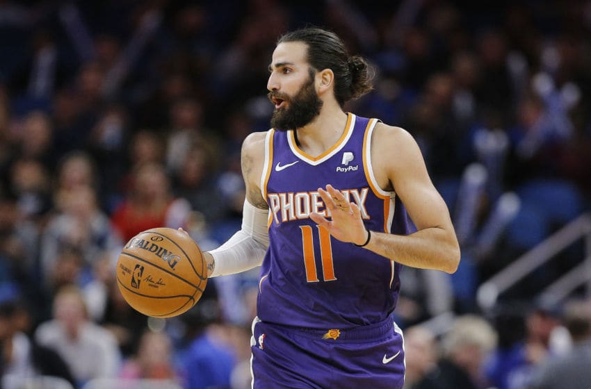 ORLANDO, FLORIDA - DECEMBER 04: Ricky Rubio #11 of the Phoenix Suns dribbles with the ball against the Orlando Magic during the second half at Amway Center on December 04, 2019 in Orlando, Florida. NOTE TO USER: User expressly acknowledges and agrees that, by downloading and/or using this photograph, user is consenting to the terms and conditions of the Getty Images License Agreement. (Photo by Michael Reaves/Getty Images)