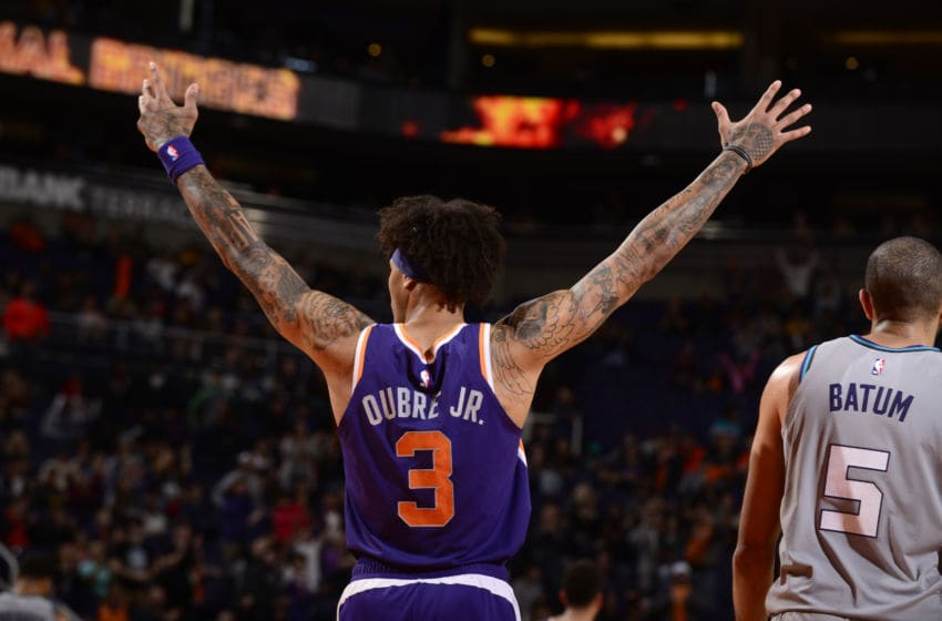 PHOENIX, AZ - JANUARY 12: Kelly Oubre Jr. #3 of the Phoenix Suns reacts to play against the Charlotte Hornets on January 12, 2020 at Talking Stick Resort Arena in Phoenix, Arizona. NOTE TO USER: User expressly acknowledges and agrees that, by downloading and or using this photograph, user is consenting to the terms and conditions of the Getty Images License Agreement. Mandatory Copyright Notice: Copyright 2020 NBAE (Photo by Barry Gossage/NBAE via Getty Images)