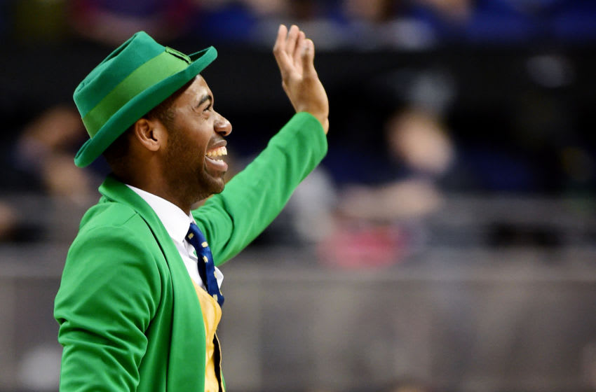 GREENSBORO, NORTH CAROLINA - MARCH 11: The Notre Dame Fighting Irish mascot waves to the crowd during their game against the Boston College Eagles in the second round of the 2020 Men's ACC Basketball Tournament at Greensboro Coliseum on March 11, 2020 in Greensboro, North Carolina. (Photo by Jared C. Tilton/Getty Images)