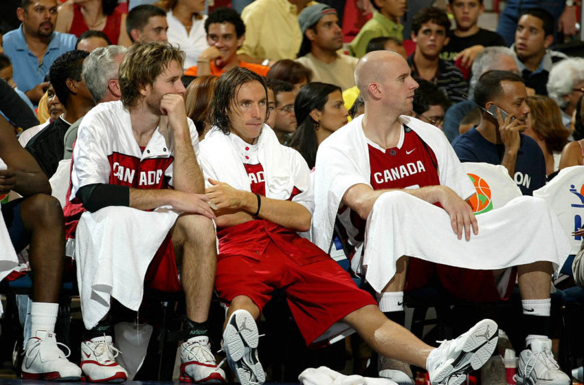 SAN JUAN, PUERTO RICO - AUGUST 30: ***PUERTO RICO OUT, INTERNET OUT *** (L-R) Canadian players Jeffery Swords, Steven Nash and Gregory Newton watch the Olympic qualifying game between Canada and Argentina on August 30, 2003 at Roberto Clemente Coliseum in San Juan, Puerto Rico. Argentina defeated Canada 88-72. NOTE TO USER: User expressly acknowledges and agrees that, by downloading and or using this photograph, User is consenting to the terms and conditions of the Getty Images License Agreement. (Photo by Jose Jimenez/Primera Hora/Getty Images)