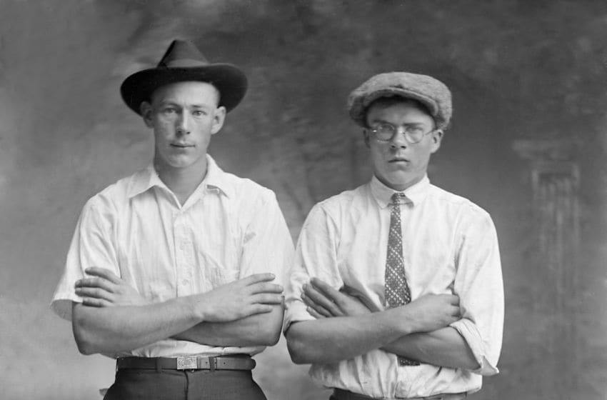 Two men appear to be unhappy and angry about having to have their studio portrait taken. (Photo by Kirn Vintage Stock/Corbis via Getty Images)