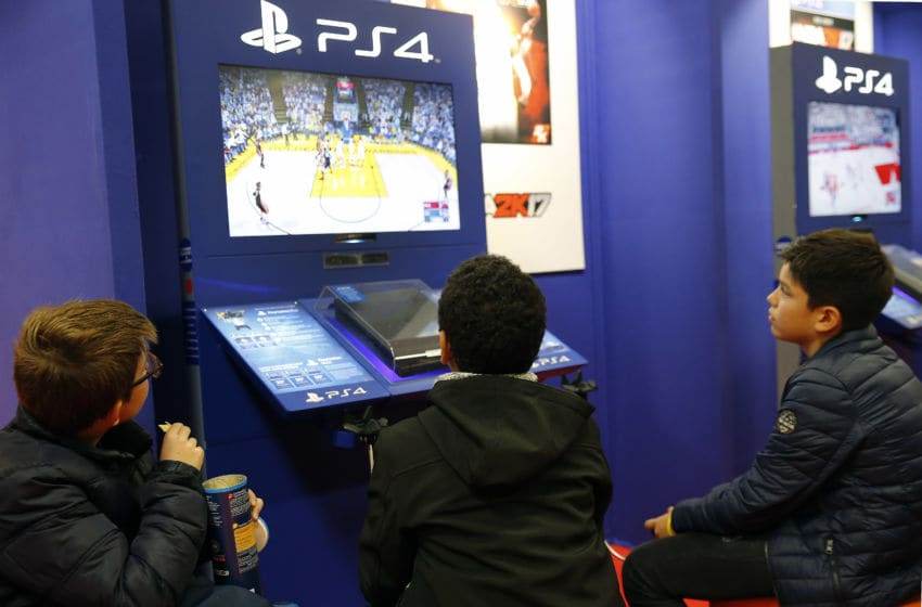 PARIS, FRANCE - OCTOBER 27: Visitors play the video game