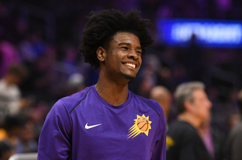 LOS ANGELES, CA - DECEMBER 20: Phoenix Suns Forward Josh Jackson (20) is all smiles before an NBA game between the Phoenix Suns and the Los Angeles Clippers on December 20, 2017 at STAPLES Center in Los Angeles, CA. (Photo by Brian Rothmuller/Icon Sportswire via Getty Images)