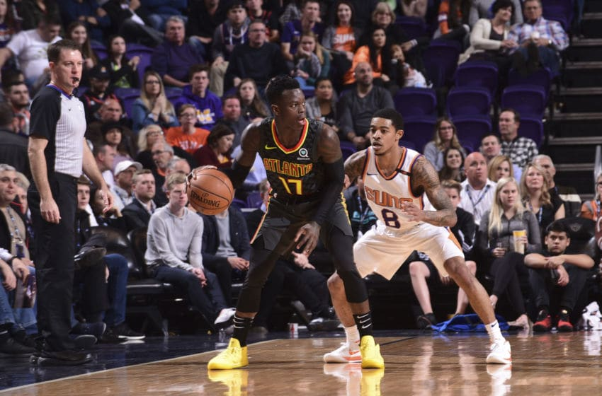 PHOENIX, AZ - JANUARY 2: Dennis Schroder #17 of the Atlanta Hawks handles the ball against Tyler Ulis #8 of the Phoenix Suns on January 2, 2018 at Talking Stick Resort Arena in Phoenix, Arizona. NOTE TO USER: User expressly acknowledges and agrees that, by downloading and or using this photograph, user is consenting to the terms and conditions of the Getty Images License Agreement. Mandatory Copyright Notice: Copyright 2018 NBAE (Photo by Michael Gonzales/NBAE via Getty Images)