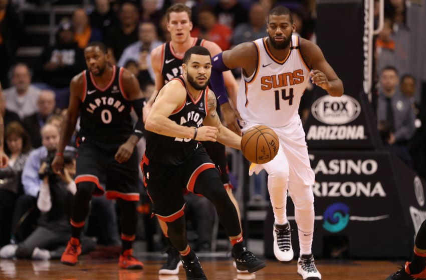 PHOENIX, AZ - DECEMBER 13: Fred VanVleet #23 of the Toronto Raptors moves the ball upcourt ahead of Greg Monroe #14 of the Phoenix Suns during the first half of the NBA game at Talking Stick Resort Arena on December 13, 2017 in Phoenix, Arizona. NOTE TO USER: User expressly acknowledges and agrees that, by downloading and or using this photograph, User is consenting to the terms and conditions of the Getty Images License Agreement. (Photo by Christian Petersen/Getty Images)
