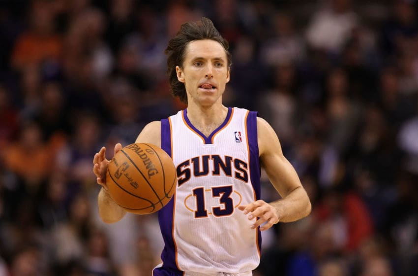 PHOENIX, AZ - FEBRUARY 19: Steve Nash #13 of the Phoenix Suns moves the ball upcourt during the NBA game against the Los Angeles Lakers at US Airways Center on February 19, 2012 in Phoenix, Arizona. The Suns defeated the Lakers 102-90. NOTE TO USER: User expressly acknowledges and agrees that, by downloading and or using this photograph, User is consenting to the terms and conditions of the Getty Images License Agreement. (Photo by Christian Petersen/Getty Images)