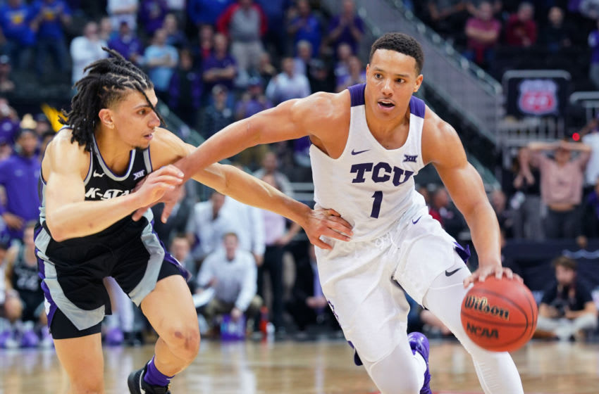 KANSAS CITY, MISSOURI - MARCH 11: Desmond Bane #1 of the TCU Horned Frogs drives to the basket against Mike McGuirl #0) of the Kansas State Wildcats in the second half during the first round of the Big 12 Basketball Tournament at Sprint Center on March 11, 2020 in Kansas City, Missouri. (Photo by Ed Zurga/Getty Images)