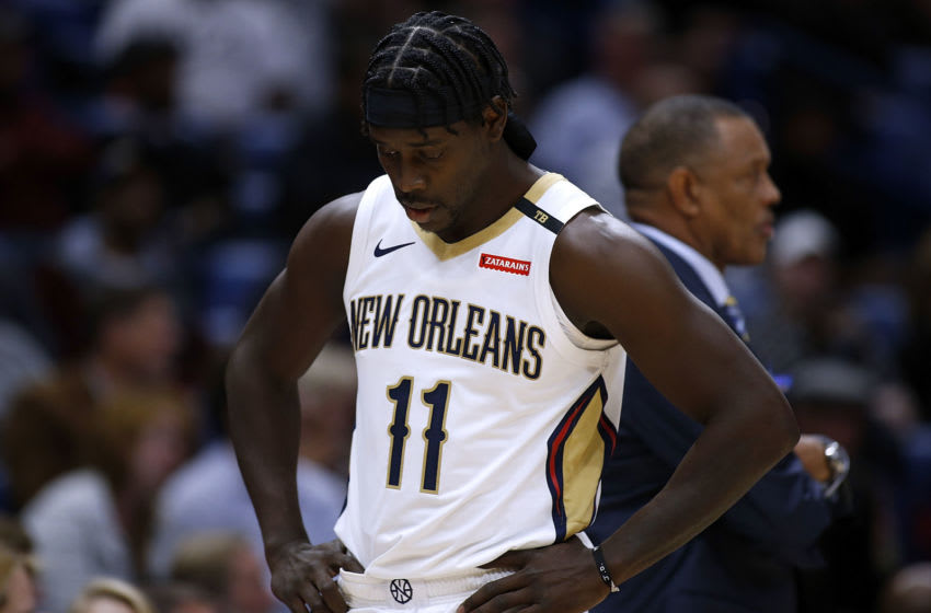 NEW ORLEANS, LA - NOVEMBER 10: Jrue Holiday #11 of the New Orleans Pelicans and heach coach Alvin Gentry react during the first half against the Phoenix Suns at the Smoothie King Center on November 10, 2018 in New Orleans, Louisiana. NOTE TO USER: User expressly acknowledges and agrees that, by downloading and or using this photograph, User is consenting to the terms and conditions of the Getty Images License Agreement. (Photo by Jonathan Bachman/Getty Images)