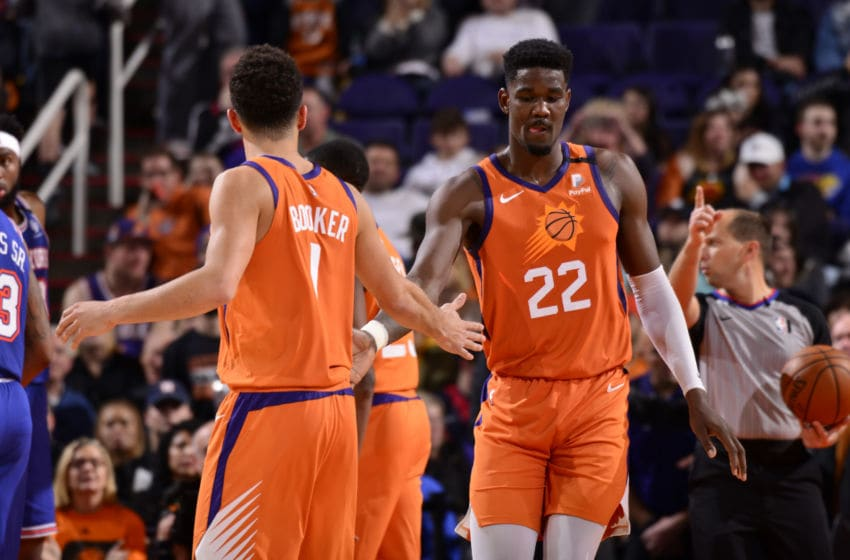 PHOENIX, AZ - JANUARY 3: Devin Booker #1, and Deandre Ayton #22 of the Phoenix Suns hi-five each other during the game against the New York Knicks on January 3, 2020 at Talking Stick Resort Arena in Phoenix, Arizona. NOTE TO USER: User expressly acknowledges and agrees that, by downloading and or using this photograph, user is consenting to the terms and conditions of the Getty Images License Agreement. Mandatory Copyright Notice: Copyright 2020 NBAE (Photo by Barry Gossage/NBAE via Getty Images)