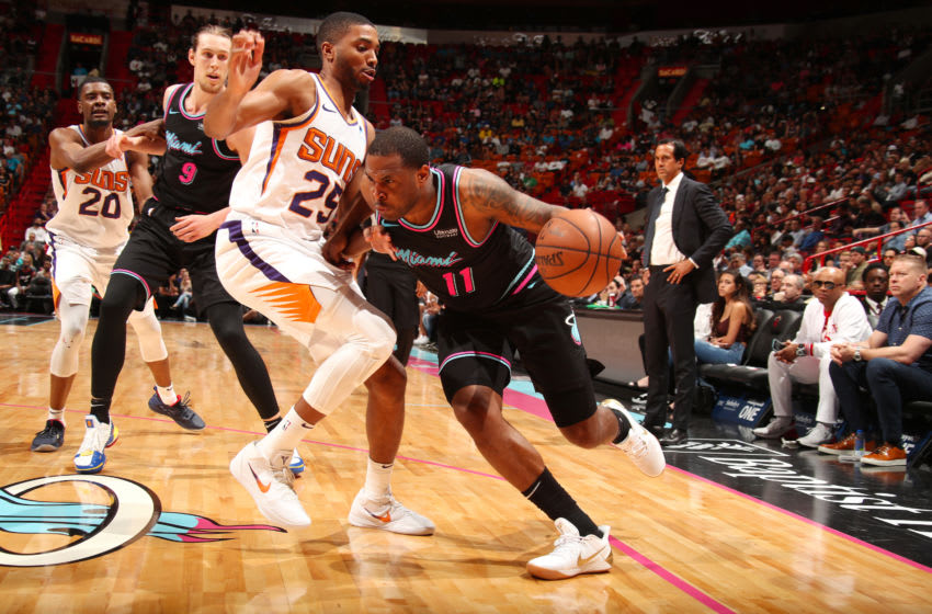 MIAMI, FL - FEBRUARY 25: Dion Waiters #11 of the Miami Heat jocks for a position during the game against Mikal Bridges #25 of the Phoenix Suns on February 25, 2019 at American Airlines Arena in Miami, Florida. NOTE TO USER: User expressly acknowledges and agrees that, by downloading and or using this Photograph, user is consenting to the terms and conditions of the Getty Images License Agreement. Mandatory Copyright Notice: Copyright 2019 NBAE (Photo by Issac Baldizon/NBAE via Getty Images)