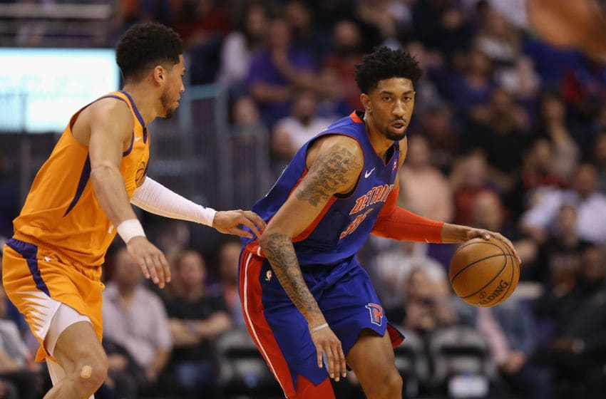PHOENIX, ARIZONA - FEBRUARY 28: Christian Wood #35 of the Detroit Pistons handles the ball against Devin Booker #1 of the Phoenix Suns during the first half of the NBA game at Talking Stick Resort Arena on February 28, 2020 in Phoenix, Arizona. NOTE TO USER: User expressly acknowledges and agrees that, by downloading and or using this photograph, user is consenting to the terms and conditions of the Getty Images License Agreement. Mandatory Copyright Notice: Copyright 2020 NBAE. (Photo by Christian Petersen/Getty Images)