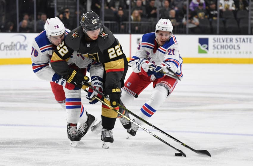 LAS VEGAS, NV - JANUARY 08: Nick Holden #22 of the Vegas Golden Knights battles Brady Skjei #76 of the New York Rangers for the puck during the second period at T-Mobile Arena on January 8, 2019 in Las Vegas, Nevada. (Photo by Jeff Bottari/NHLI via Getty Images)