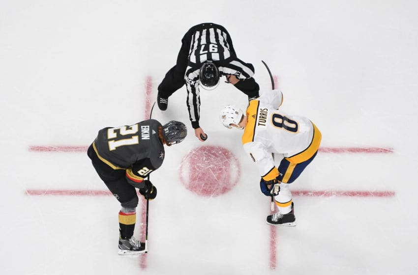 LAS VEGAS, NV - FEBRUARY 16: Cody Eakin #21 of the Vegas Golden Knights faces off with Kyle Turris #8 of the Nashville Predators during the second period at T-Mobile Arena on February 16, 2019 in Las Vegas, Nevada. (Photo by Jeff Bottari/NHLI via Getty Images)
