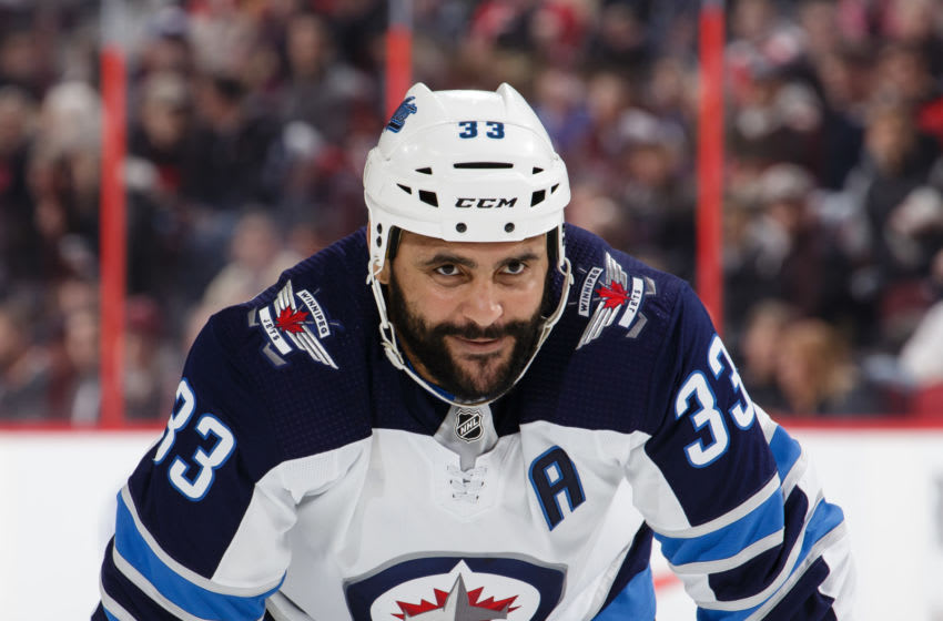 OTTAWA, ON - FEBRUARY 9: Dustin Byfuglien #33 of the Winnipeg Jets looks on during a face-off against the Ottawa Senators at Canadian Tire Centre on February 9, 2019 in Ottawa, Ontario, Canada. (Photo by Jana Chytilova/Freestyle Photography/Getty Images)