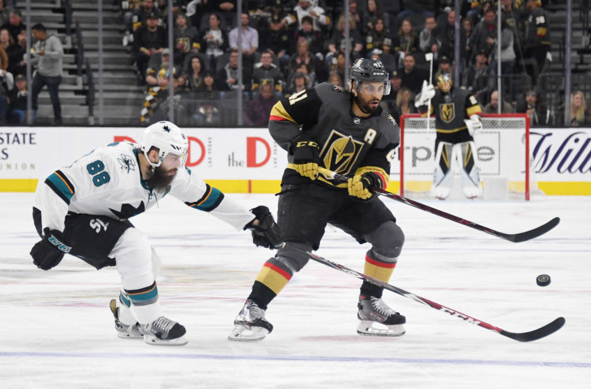 Pierre-Edouard Bellemare #41 of the Vegas Golden Knights passes the puck under pressure from Brent Burns #88 of the San Jose Sharks. (Photo by Ethan Miller/Getty Images)