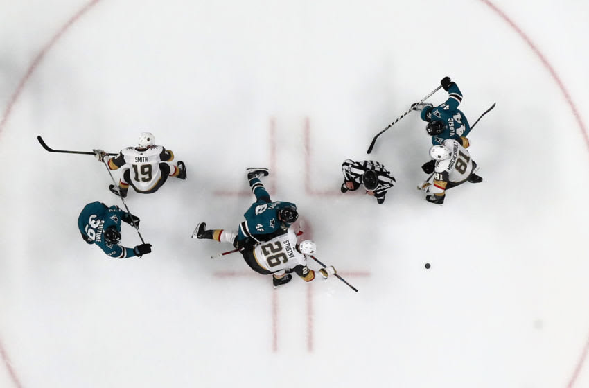 SAN JOSE, CALIFORNIA - APRIL 23: Paul Stastny #26 of the Vegas Golden Knights and Tomas Hertl #48 of the San Jose Sharks go for a face off in Game Seven of the Western Conference First Round during the 2019 NHL Stanley Cup Playoffs at SAP Center on April 23, 2019 in San Jose, California. (Photo by Ezra Shaw/Getty Images)