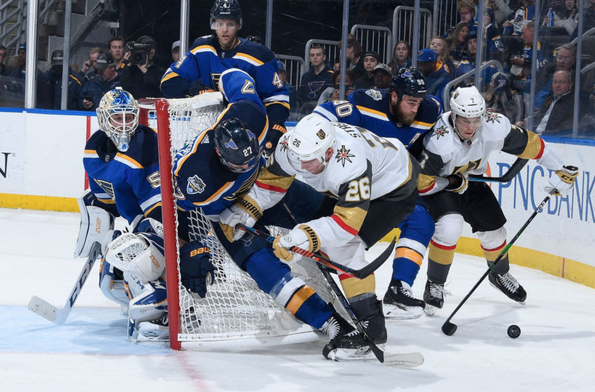 ST. LOUIS, MO - DECEMBER 12: Jordan Binnington #50 Alex Pietrangelo #27 and Ryan O'Reilly #90 of the St. Louis Blues defend the net against Paul Stastny #26 and Valentin Zykov of the Vegas Golden Knights at Enterprise Center on December 12, 2019 in St. Louis, Missouri. (Photo by Scott Rovak/NHLI via Getty Images)