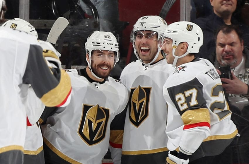 Chandler Stephenson #20 of the Vegas Golden Knights is joined by Alex Tuch #89 (L) and Shea Theodore #27 (R). (Photo by Bruce Bennett/Getty Images)