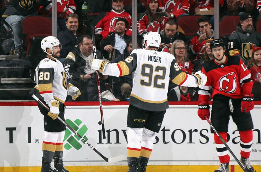 NEWARK, NEW JERSEY - DECEMBER 03: Chandler Stephenson #20 of the Vegas Golden Knights (L) scores at 5:24 of the second period against the New Jersey Devils and is joined by Tomas Nosek #92 (R) at the Prudential Center on December 03, 2019 in Newark, New Jersey. (Photo by Bruce Bennett/Getty Images)