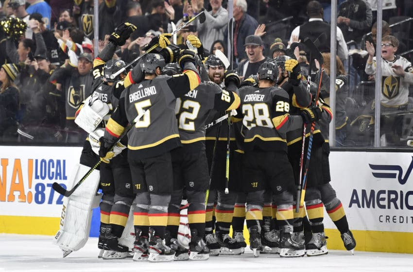 LAS VEGAS, NEVADA - JANUARY 04: The Vegas Golden Knights celebrate after the game-winning goal by Chandler Stephenson #20 in overtime against the St. Louis Blues at T-Mobile Arena on January 04, 2020 in Las Vegas, Nevada. (Photo by Jeff Bottari/NHLI via Getty Images)