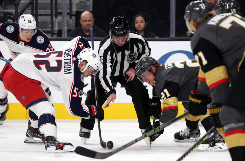 LAS VEGAS, NEVADA - JANUARY 11: Cody Eakin #21 of the Vegas Golden Knights faces off with Emil Bemstrom #52 of the Columbus Blue Jackets during the first period at T-Mobile Arena on January 11, 2020 in Las Vegas, Nevada. (Photo by Zak Krill/NHLI via Getty Images)