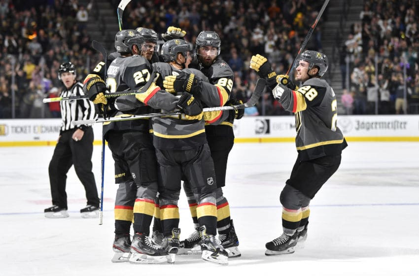LAS VEGAS, NEVADA - FEBRUARY 08: Cody Eakin #21 of the Vegas Golden Knights celebrates with teammates after scoring a goal during the third period against the Carolina Hurricanes at T-Mobile Arena on February 08, 2020 in Las Vegas, Nevada. (Photo by Jeff Bottari/NHLI via Getty Images)