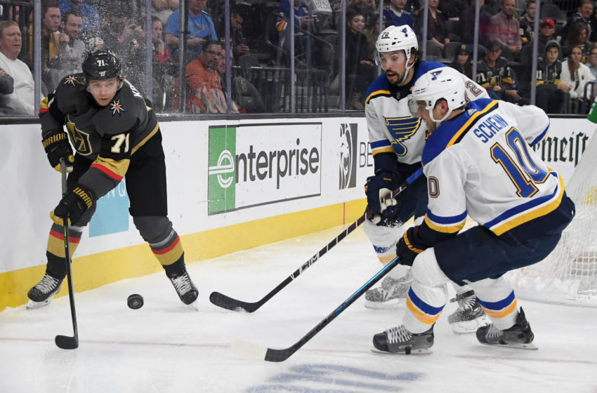 William Karlsson #71 of the Vegas Golden Knights passes against Justin Faulk #72 and Brayden Schenn #10 of the St. Louis Blues. (Photo by Ethan Miller/Getty Images)