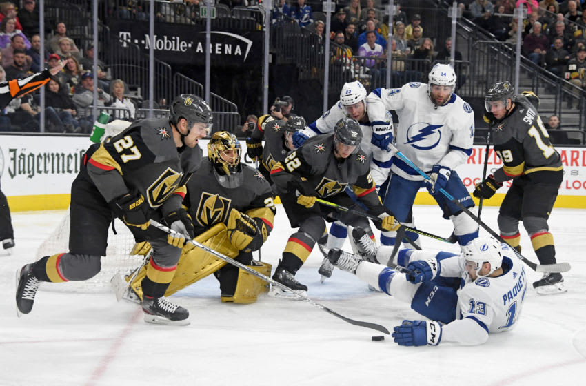 Shea Theodore #27 of the Vegas Golden Knights clears the puck. (Photo by Ethan Miller/Getty Images)