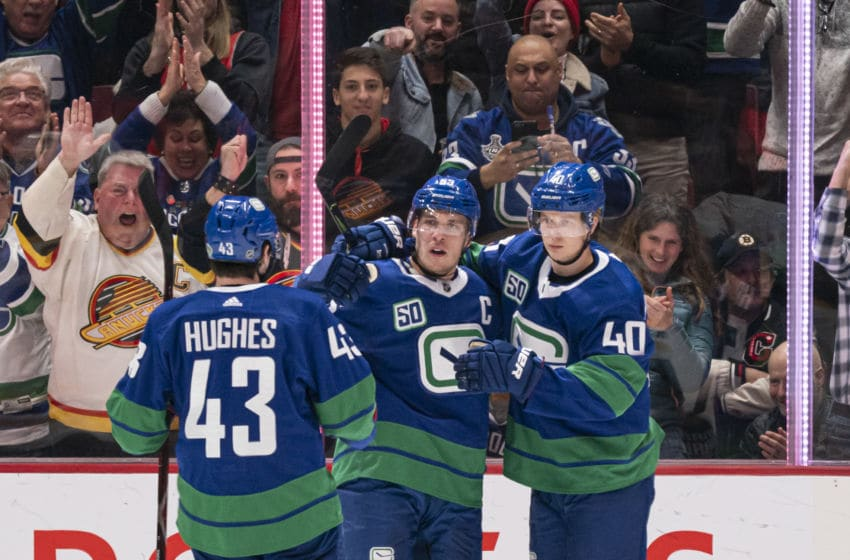 Vancouver Canucks, Bo Horvat#53, Quinn Hughes #43 and Elias Pettersson #40. (Photo by Rich Lam/Getty Images)