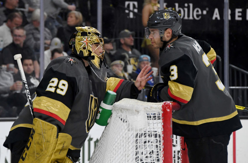 LAS VEGAS, NEVADA - MARCH 01: Marc-Andre Fleury #29 and Brayden McNabb #3 of the Vegas Golden Knights talk during a stop in play in the first period of their game against the Los Angeles Kings at T-Mobile Arena on March 1, 2020 in Las Vegas, Nevada. The Kings defeated the Golden Knights 4-1. (Photo by Ethan Miller/Getty Images)