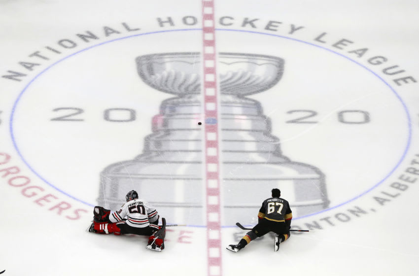 Corey Crawford #50 of the Chicago Blackhawks stretches along with Max Pacioretty #67 of the Vegas Golden Knights before the start of Game One of the Western Conference First Round during the 2020 NHL Stanley Cup Playoffs. (Photo by Jeff Vinnick/Getty Images)