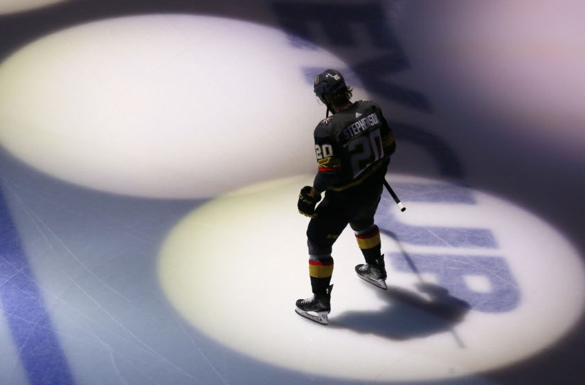 Chandler Stephenson #20 of the Vegas Golden Knights skates through the spotlights. (Photo by Jeff Vinnick/Getty Images)