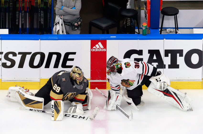 Malcolm Subban #30 of the Chicago Blackhawks and Marc-Andre Fleury #29 of the Vegas Golden Knights stretch prior to their Game Five of the Western Conference First Round.