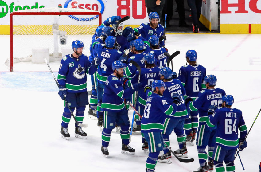 The Vancouver Canucks celebrate their win over the St. Louis Blues in Game Six of the Western Conference First Round during the 2020 NHL Stanley Cup Playoffs. (Photo by Jeff Vinnick/Getty Images)