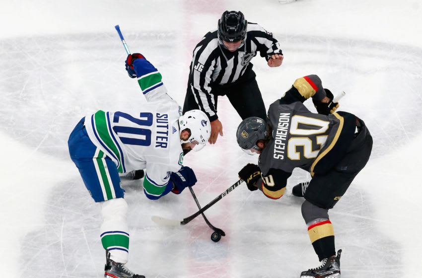 Linesman Jonny Murray #95 drops the puck between Chandler Stephenson #20 of the Vegas Golden Knights and Brandon Sutter #20 of the Vancouver Canucks in Game One of the Western Conference Second Round. (Photo by Jeff Vinnick/Getty Images)