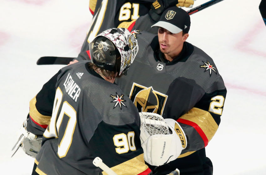 Robin Lehner #90 of the Vegas Golden Knights celebrates his 5-0 shutout against the Vancouver Canucks and is joined by Marc-Andre Fleury #29 in Game One of the Western Conference Second Round. (Photo by Jeff Vinnick/Getty Images)