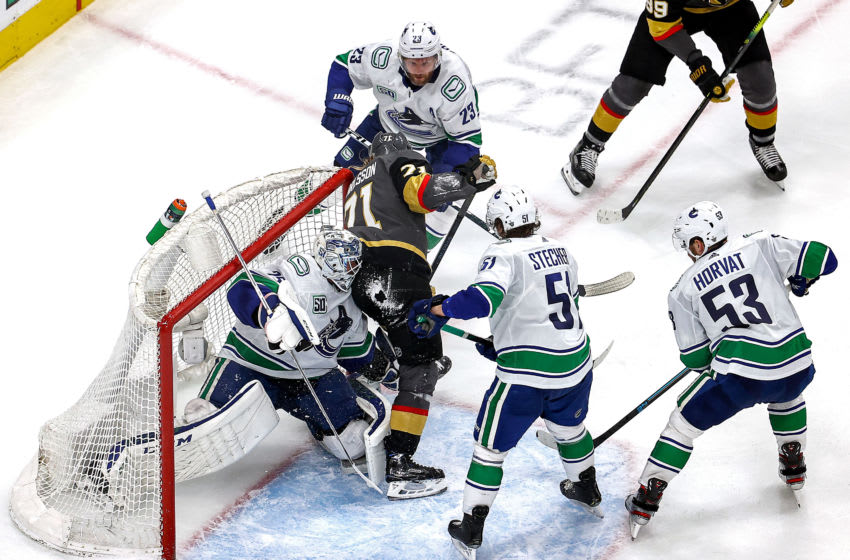 William Karlsson #71 of the Vegas Golden Knights collides with Jacob Markstrom #25 of the Vancouver Canucks during the second period in Game Two of the Western Conference Second Round. (Photo by Bruce Bennett/Getty Images)