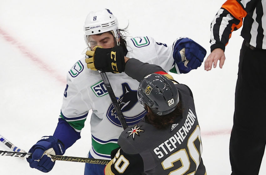 Chandler Stephenson #20 of the Vegas Golden Knights hits Christopher Tanev #8 of the Vancouver Canucks in Game Six of the Western Conference Second Round. (Photo by Bruce Bennett/Getty Images)