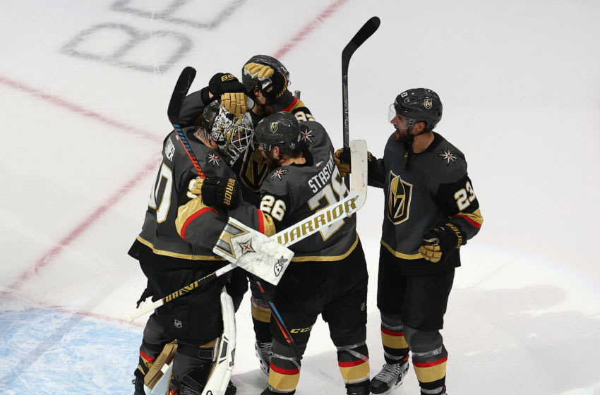 The Vegas Golden Knights celebrate with Robin Lehner after the teams 3-0 victory against the Vancouver Canucks in Game Seven of the Western Conference Second Round. (Photo by Bruce Bennett/Getty Images)